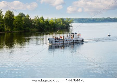 Pleasure boat moves along the Volga River in the summer