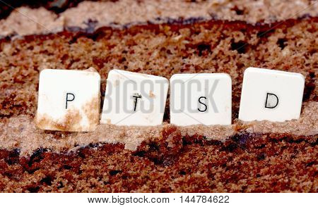 picture of a PTSD keyboard letters on a chocolate cake background