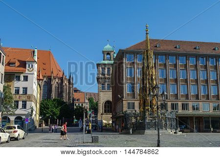 Nurnberg, Germany - August 22, 2010: Famous Schoener Brunnen fountain at Hauptmarkt square in Nurnberg.