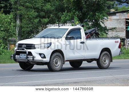 CHIANGMAI THAILAND -AUGUST 9 2016: Private Pickup car Toyota Hilux. Top Sale Pickup in thailand. On road no.1001 8 km from Chiangmai Business Area.