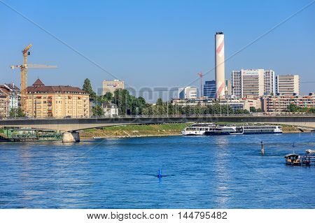 Basel, Switzerland - 27 August, 2016: view along the Rhine river. Basel is a city in Switzerland located where borders of France Germany and Switzerland meet.