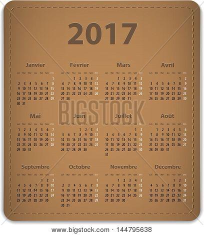 Calendar for 2017 year in French on leather background. Vector illustration