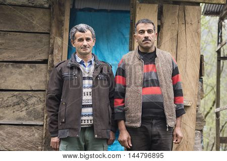 Gilan IRAN - March 22 2016: Portrait of Two Taleshi Herder in Front of a Chalet. Gilan Province