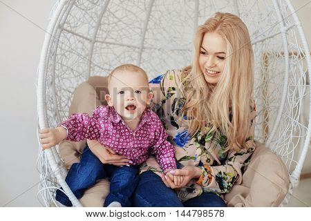 beautiful fashionable mother with young son. The concept of family