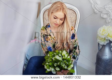 young beautiful woman with a bouquet. The concept of beauty and fashion