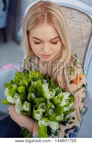 beautiful blonde with a bouquet of flowers