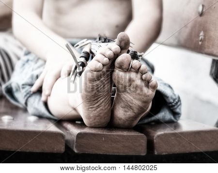 a closeup of dirty feet of a little boy