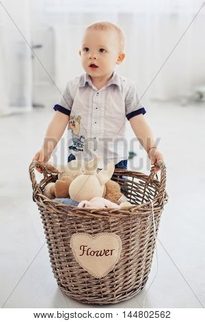 little boy with a basket for toys