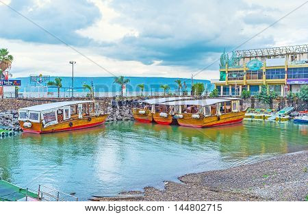 TIBERIAS ISRAEL - FEBRUARY 22 2016: The small port for the pleasure boat located at the central city promenade on February 22 in Tiberias Israel.