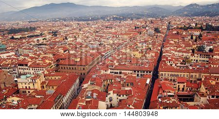 Roofs of Florence from Campanile of Florence Cathedral. Aged photo. View of Firenze city with Basilica of Santa Croce in the distance. View to the east from belfry. Italy.