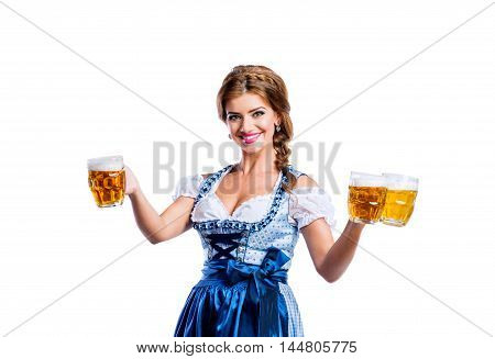 Woman In Traditional Bavarian Dress Holding Mugs Of Beer