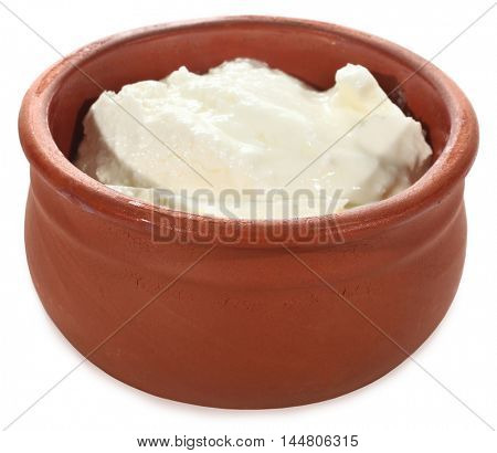 Yogurt or sour cream in clay pot