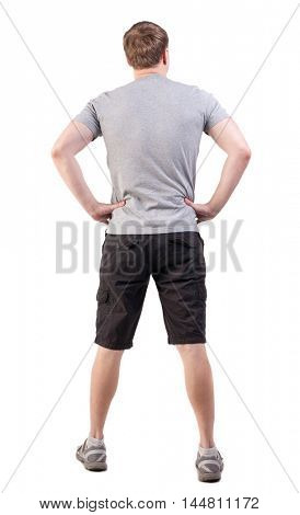 Back view of handsome man in t-shirt and  shorts  looking up.   Standing young tourist. Rear view people collection.  backside view of person.  Isolated over white background. athlete demonstrates his