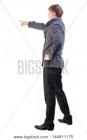 Back view of  pointing young business men in coat. blonde businessman  gesture. Rear view people collection.  backside view of person.  Isolated over white background.