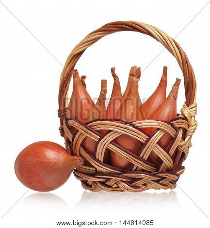 Bunch of raw young shallots in the wicker basket isolated over white background