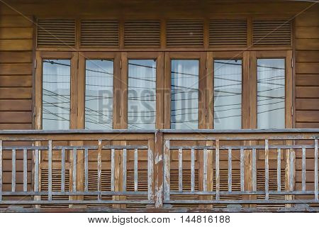 Old wooden porch and window glass with Vintage wooden house.