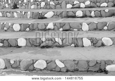 stone steps closeup with a spotty striped pattern of gray color for the abstract background or for wallpaper