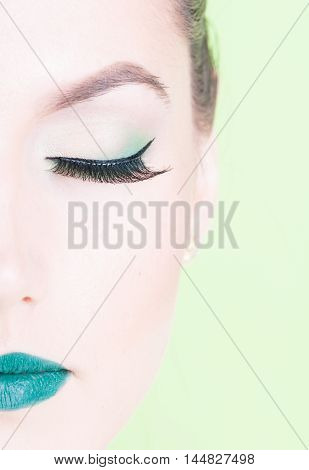 Close-up Of Half Face Professional Green Colored Make-up
