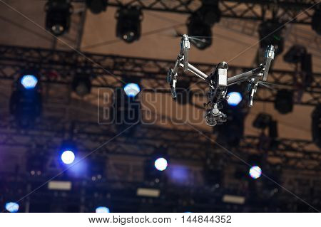Drone with camera flying over the scene and shoots video