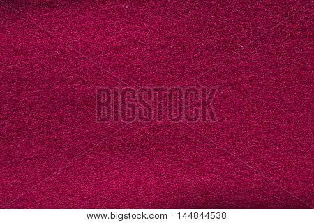 Photo of the Close up crimson woollen knitted fabric texture. Loden background