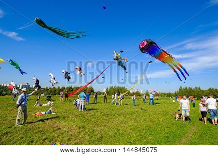 Moscow, Russia - August 27, 2016: People fly kites at open Kite Festival at sunny day time