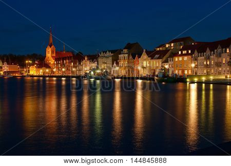 Night view on the Sonderborg. Harbour. the lights of the evening city reflected in the water.   Southern Denmark.