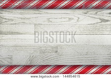 A Christmas candy cane background painted over a whitewashed wooden board.