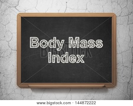 Health concept: text Body Mass Index on Black chalkboard on grunge wall background, 3D rendering