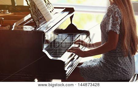 Beautiful woman playing piano