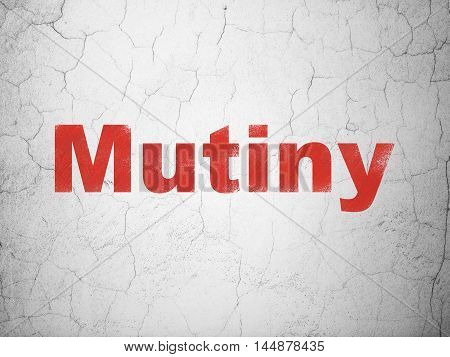 Political concept: Red Mutiny on textured concrete wall background