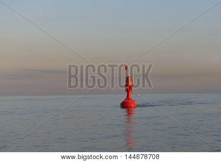 Orange buoy on the Elbe to delineate