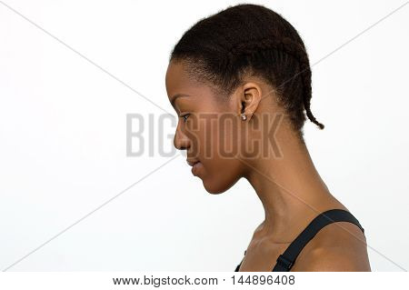 African woman on white background with braided hair. Hairstyle for sport activities