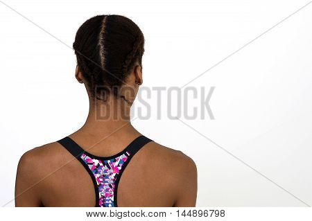 Young african woman demonstrates hairstyle with braids. Braided hairstyle for sport activities and gym training poster