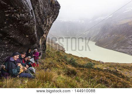 EL ALTAR ECUADOR - MARCH 08: Group of hikers walking around the crater of El Altar volcano taking a break on march 08 2015 El Altar Ecuador