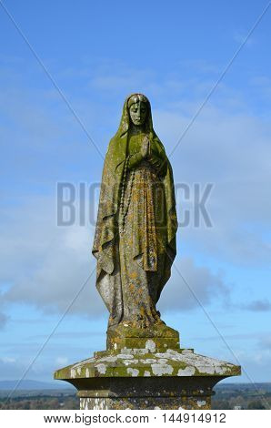 Statue of the Mother Mary in the cemetery at Rock of Cashel.