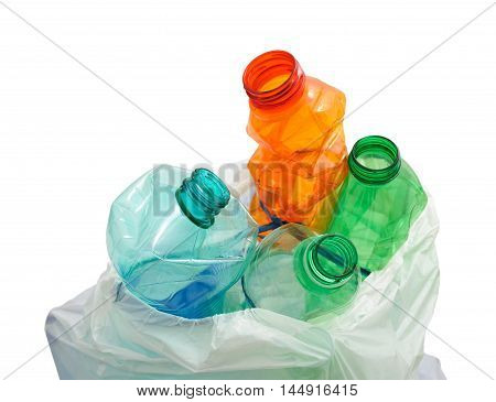Empty bottles in a recycle sack isolated