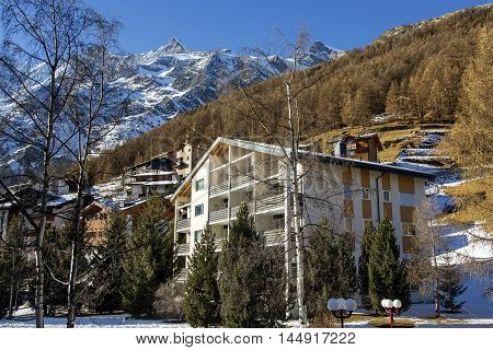 Modern hotels on a background mountains in the charming Swiss resort of Saas-Fee, Switzerland