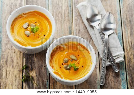 Fresh carrot and pumpkin  soup in white bowl. Dietary vegetable and healthy food.