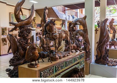 Ubud, Indonesia - August 29, 2008: Carved Wooden Statues In Souvenir Shop