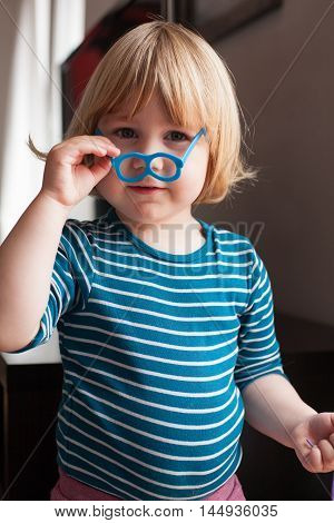 Portrait Of Little Kid With Toy Glasses