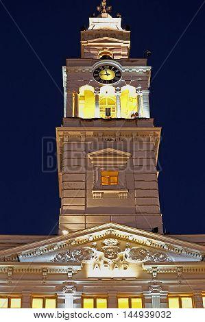 Tower of City Hall from city Arad Romania illuminated with night lighting.