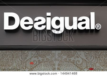 Lyon, France - August 15, 2016:  Desigual logo on a wall of a store. Desigual is a clothing brand headquartered in Barcelona, Catalonia, Spain