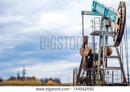 Oil pumpjack or nodding horse pumping unit. Oil industry equipment.