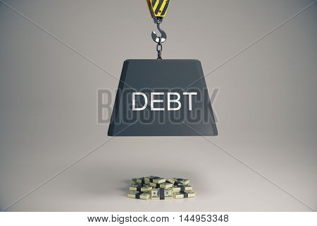 Heave block with text suspended on hook above money pile. Debt concept
