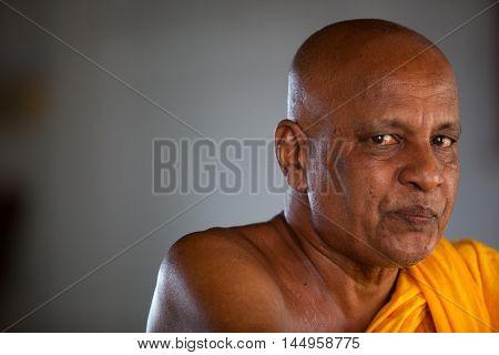 MADU GANGA - NOVEMBER 14, 2015 SRI LANKA : Portrait of a Buddhist monk in monastery at river
