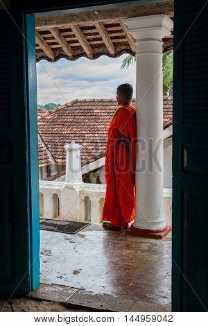 MADU GANGA - NOVEMBER 14, 2015 SRI LANKA : Buddhist monk in monastery at river