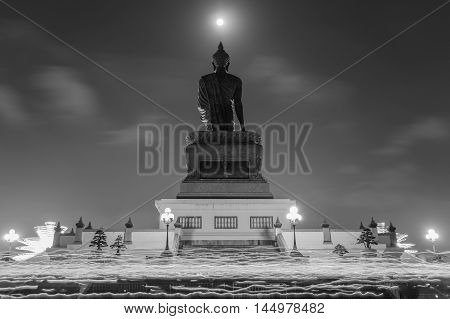 Makha Bucha Day Candle lit from buddhists are moving around Buddha statue at the Phutthamonthon district Nakhon Pathom Province of Thailand. Black and White