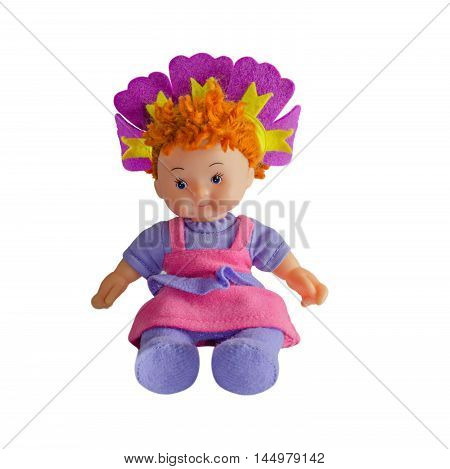 Girl doll, made from cloth, is sitting. On an isolatedbackground