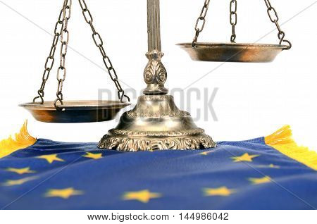 Scales of justice and Flag of European union European union law concept.