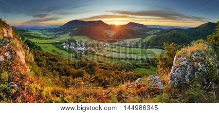 Forest - mountain panoramic view at a sunset